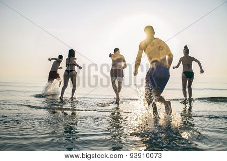 Friends Running Into The Sea