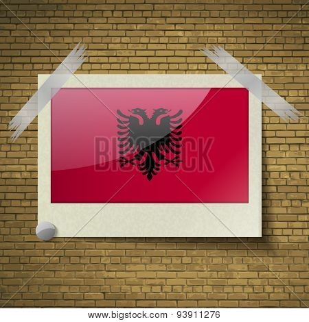 Flags Albania At Frame On A Brick Background. Vector