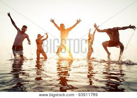 Group Of Friends Having Fun In The Water