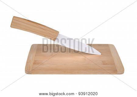 Ceramic Knife On Chopping Board