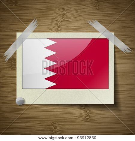 Flags Bahrain At Frame On Wooden Texture. Vector