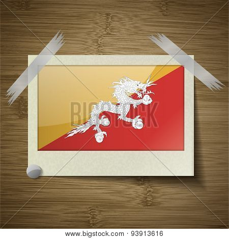 Flags Of Bhutan At Frame On Wooden Texture. Vector