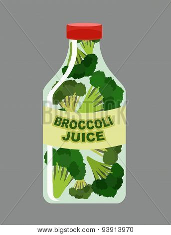 Broccoli juice. Juice from fresh vegetables. Broccoli in a transparent bottle. Vitamin drink for hea
