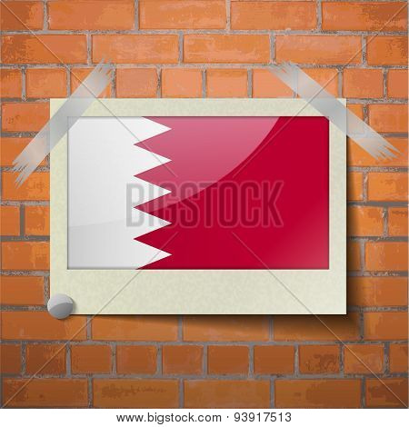 Flags Bahrain Scotch Taped To A Red Brick Wall