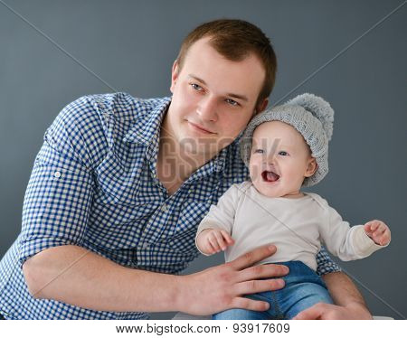 Happy Father Carrying Son Isolated On Gray Background