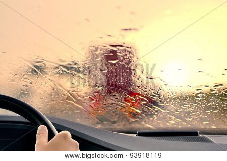 Driving on a Highway at Sunset when it starts to Rain