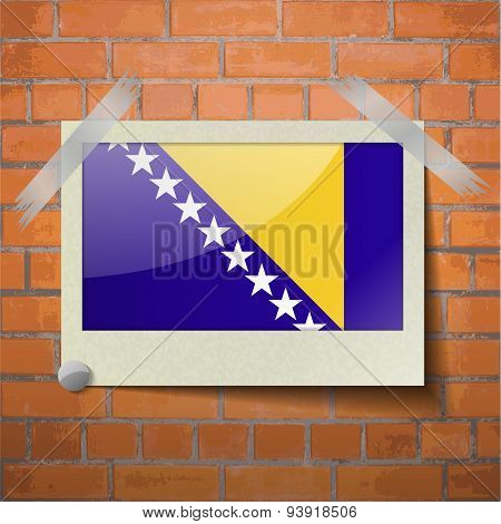 Flags Of Bosnia And Herzegovina Scotch Taped To A Red Brick Wall