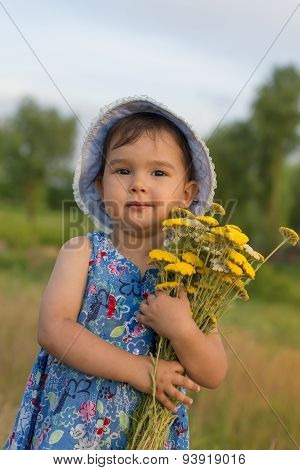Cute Little Girl Holding An Bucket Of Yarrow Flowers