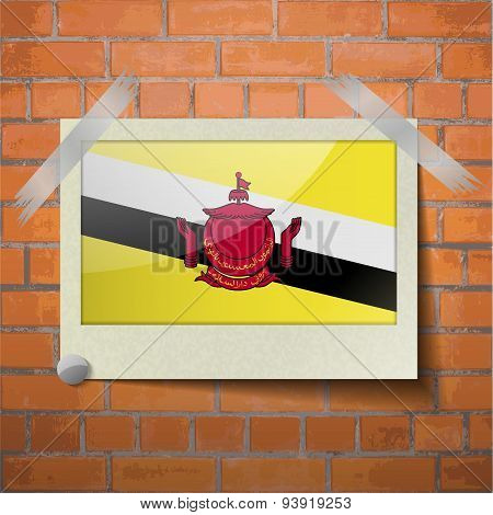 Flags Brunei Scotch Taped To A Red Brick Wall