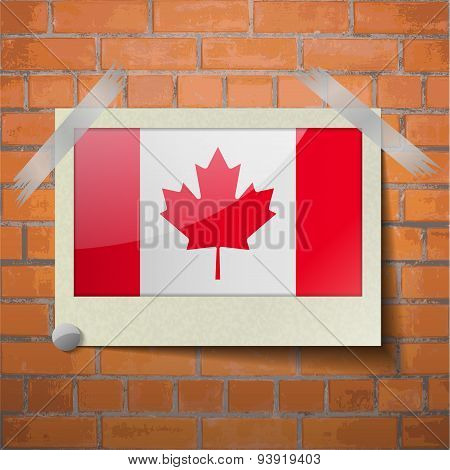 Flags Canada Scotch Taped To A Red Brick Wall