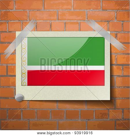 Flags Chechen Republic Scotch Taped To A Red Brick Wall