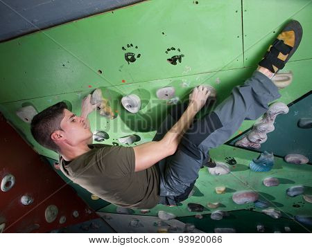 Young Man Climbing Wall Rock