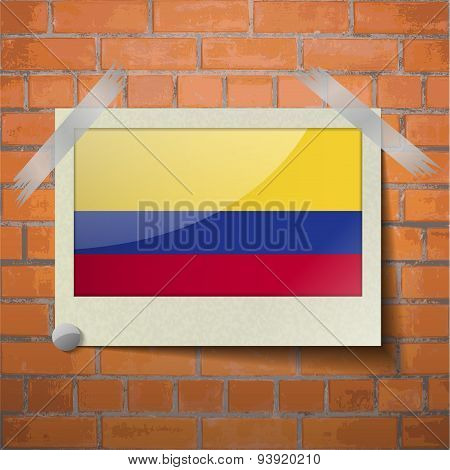Flags Colombia Scotch Taped To A Red Brick Wall