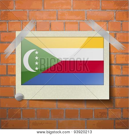 Flags Comoros Scotch Taped To A Red Brick Wall