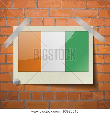 Flags Cote Dlvoire Scotch Taped To A Red Brick Wall