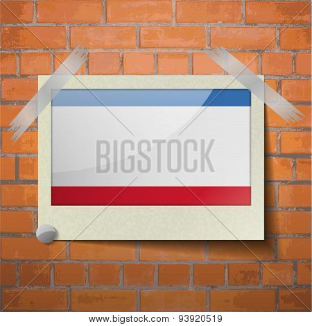 Flags Crimea Scotch Taped To A Red Brick Wall