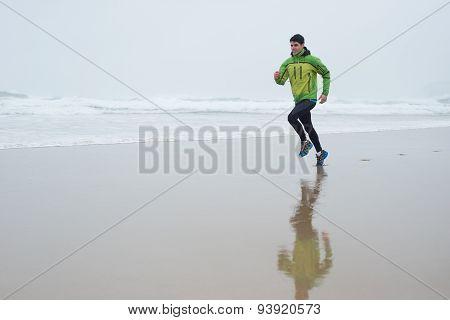 Runner Man Running On The Beach