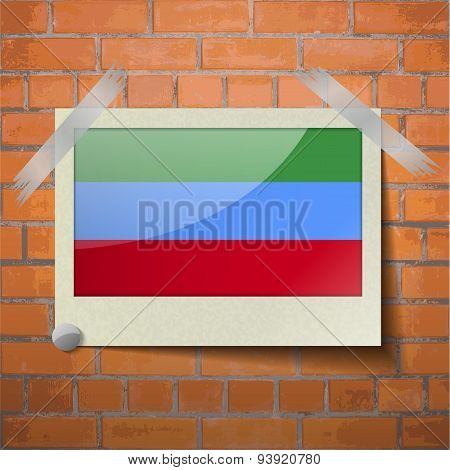 Flags Dagestan Scotch Taped To A Red Brick Wall