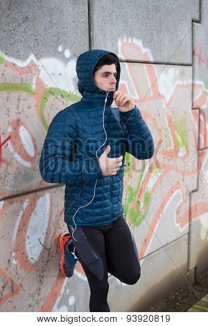 Athlete Man Leaning Against A Wall