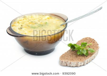 Dish With Soup And Slice Of Black Bread With Parley