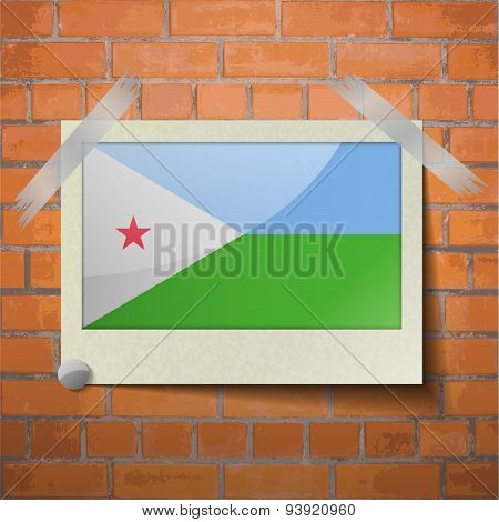 Flags Djibouti Scotch Taped To A Red Brick Wall