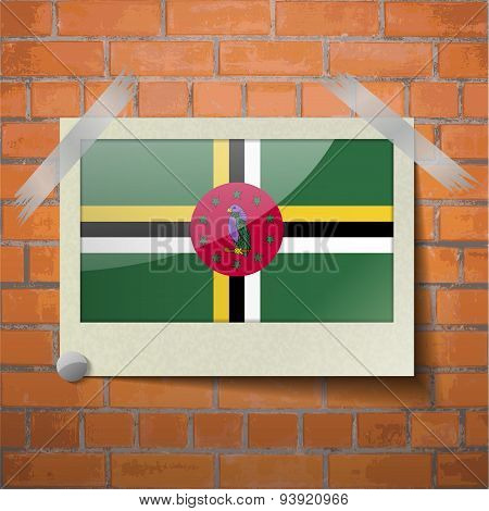 Flags Dominica Scotch Taped To A Red Brick Wall