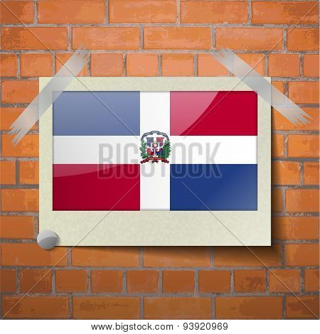 Flags Dominican Republic Scotch Taped To A Red Brick Wall