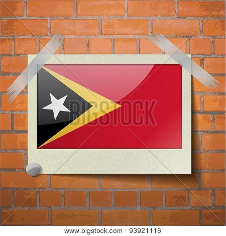 Flags East Timor Scotch Taped To A Red Brick Wall