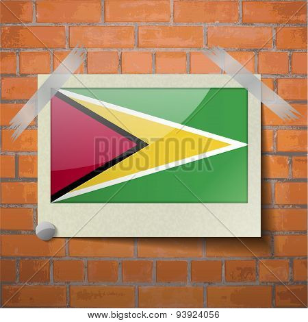 Flags Guyana Scotch Taped To A Red Brick Wall