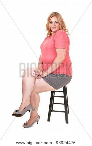 Young Plus Size Woman Sitting.