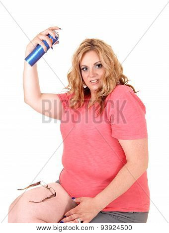 Plus Size Woman Straying Hairspray On.