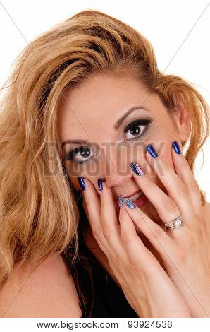 Beautiful Woman With Finger On Face.