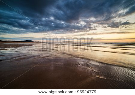 Beach At Sunset In A Stormy Day