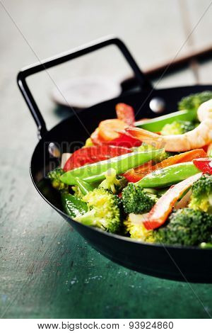Fresh vegetables and shrimps on pan. Food background