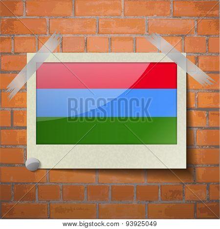 Flags Karelia Scotch Taped To A Red Brick Wall