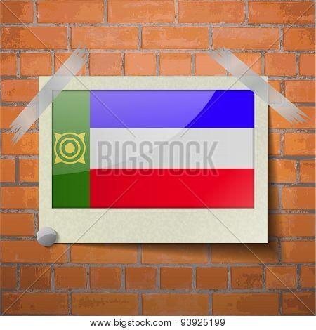 Flags Khakassia Scotch Taped To A Red Brick Wall