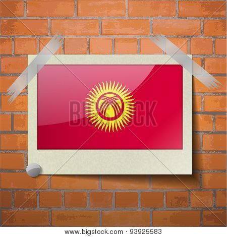 Flags Kyrgyzstan Scotch Taped To A Red Brick Wall