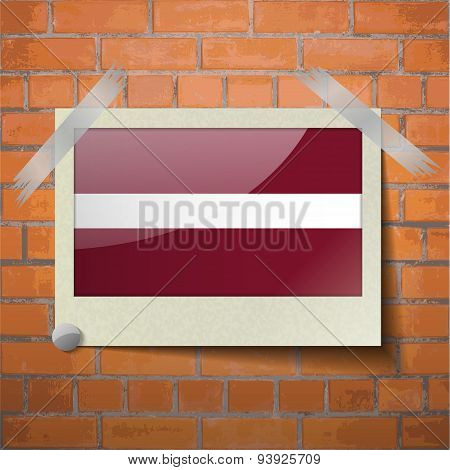 Flags Latvia Scotch Taped To A Red Brick Wall