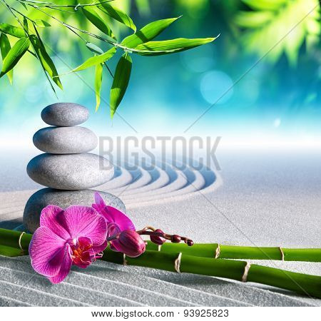 sand, orchid and massage stones in zen garden