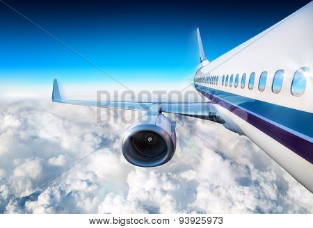 airplane over clouds flying in blue sky