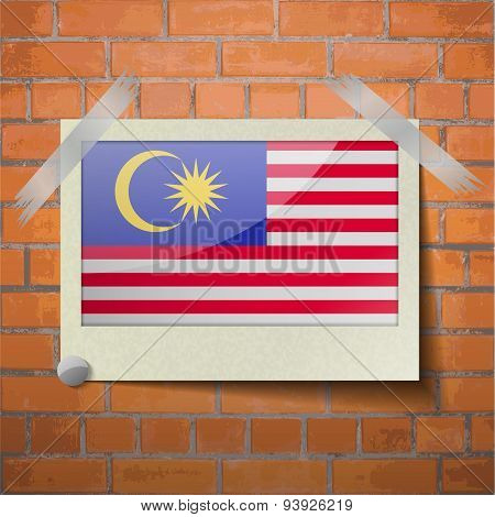 Flags Malaysia Scotch Taped To A Red Brick Wall