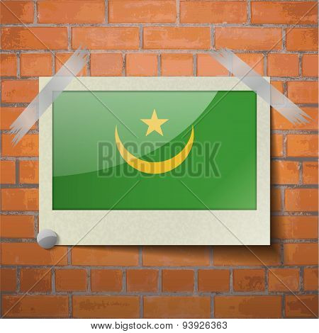 Flags Mauritania Scotch Taped To A Red Brick Wall