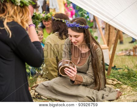 Warsaw, Poland -JUNE 20: Girl shows pottery handmade on festival of midsommar near the old town in Warsaw, Poland June 20, 2015
