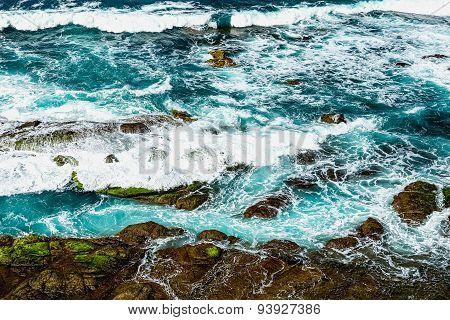 Stones In Waves Of Ocean
