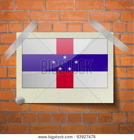 Flags Netherlands Antilles Scotch Taped To A Red Brick Wall