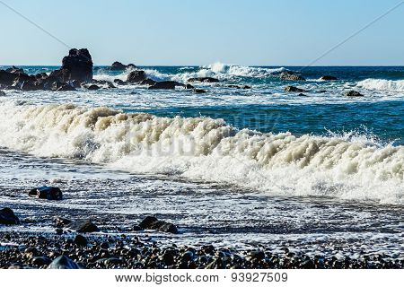 Waves And Foam On Wild Stone Beach