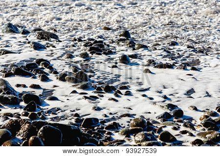 Stones In White Foam