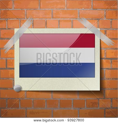 Flags Netherlands Scotch Taped To A Red Brick Wall