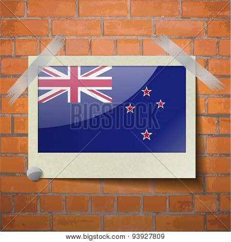 Flags New Zeland Scotch Taped To A Red Brick Wall