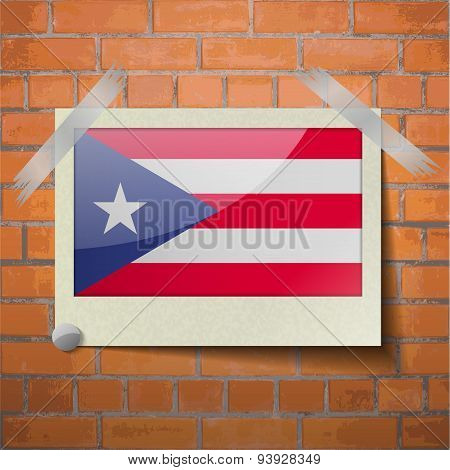 Flags Purto Rico Scotch Taped To A Red Brick Wall